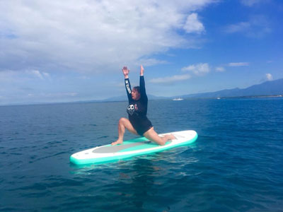 Yoga on a surf board