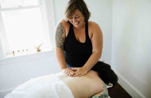Catrina Braatz Weed giving a massage to a client